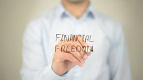 Financial Freedom, man writing on transparent screen royalty free stock image