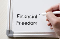 Financial freedom written on whiteboard Stock Images