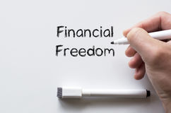 Financial freedom written on whiteboard Royalty Free Stock Photography