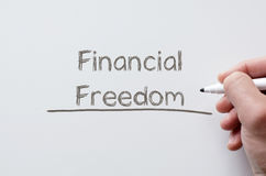 Financial freedom written on whiteboard Stock Image