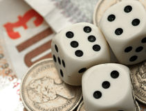 Financial Gamble. UK sterling and dice Royalty Free Stock Images