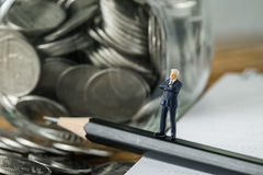 Financial goal or target consultant with a miniature businessman Stock Photography