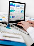 Financial graph and charts. Man showing graph and charts Royalty Free Stock Image