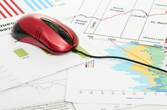 Financial graph with computer mouse Royalty Free Stock Photography