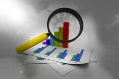 Financial graph and magnifying glass Royalty Free Stock Image