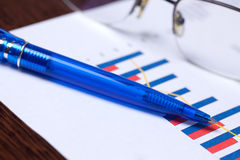 Financial graph and pen Royalty Free Stock Photo