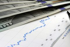 Financial graph with US currency Stock Photos