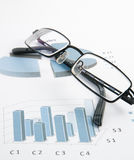 Financial graphics. With glasses (blue colour Stock Image