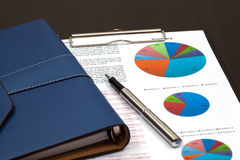 Financial graphs analysis. On table Stock Images