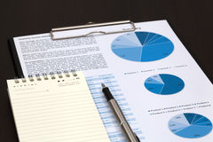 Financial graphs analysis. On table Royalty Free Stock Image