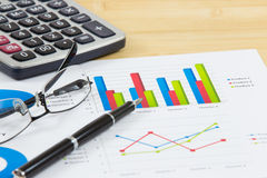 Financial graphs analysis on table Stock Image