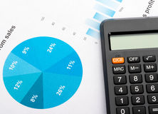 Financial graphs and charts analysis with calculator Stock Images