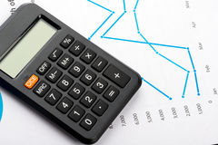 Financial graphs and charts analysis with calculator Royalty Free Stock Image