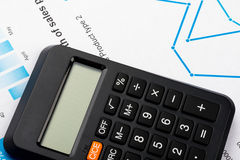 Financial graphs and charts analysis with calculator Stock Photography