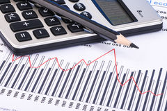 Financial graphs and charts. Financial charts and graphs with calculator, pencil Royalty Free Stock Photos