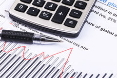 Financial graphs and charts. Financial charts and graphs on paper Stock Image