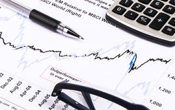 Financial graphs and charts. Financial charts and graphs on paper Stock Photos