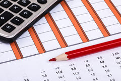 Financial graphs and charts. Financial charts and graphs on paper Royalty Free Stock Images