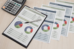 Financial graphs and charts. On table Stock Photo