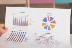 Financial graphs and charts on wooden table. Business concept Stock Image