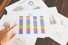 Financial graphs and charts on wooden table. Business concept Royalty Free Stock Photography