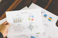Financial graphs and charts on wooden table Stock Images