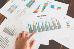 Financial graphs and charts on wooden table. Business concept Royalty Free Stock Images