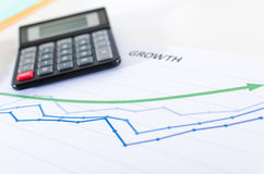 Financial graphs showing growth with calculator Royalty Free Stock Photography
