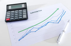 Financial graphs showing growth with calculator Stock Photo