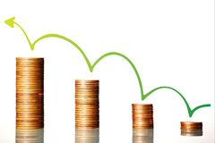 Financial growth. A picture presenting four piles of coins with a green arrow going up and symbolizing financial growth Stock Image