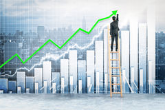 Financial growth concept. Back view of businessman on ladder drawing upward green arrow on city and and business chart background. Financial growth concept. 3D Stock Photos