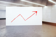 Financial growth concept. Billboard with red chart arrow in concrete room. Financial growth concept. 3D Rendering Royalty Free Stock Photos