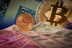 Financial growth concept with golden bitcoin above dollar and yuan bills royalty free stock photos