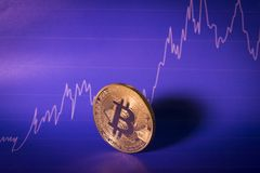 Financial growth concept with golden Bitcoins on chart background. stock images