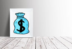Financial growth concept. Picture frame with creative blue money bag sketch placed on wooden surface. Financial growth concept. 3D Rendering Royalty Free Stock Photography