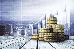 Financial growth concept. Piles of golden coins placed on wooden desktop. City with business chart in the background. Financial growth concept. 3D Rendering Stock Photo