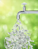 Financial growth dollar faucet. Dollar bills flowing from an open faucet on green background. Financial growth concept. 3D Rendering Royalty Free Stock Photo