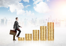 Financial growth man on coins Royalty Free Stock Images