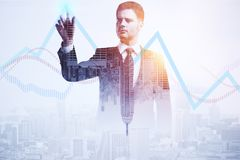 Financial growth and success concept. Businessman pointing at business chart lines on abstract city background. Financial growth and success concept. Double Stock Images