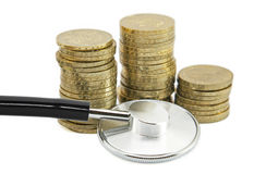 Financial health. Stethoscope and coins. Clipping path included Stock Images