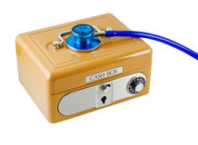 Financial Health. Concept - a stethoscope on a cash box, isolated on white with clipping path Stock Photography