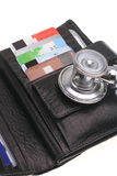 Financial health. Stethoscope, credit card and purse Stock Image