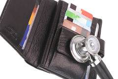 Financial health. Stethoscope, credit card and purse Royalty Free Stock Images