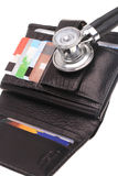 Financial health. Stethoscope, credit card and purse Stock Photos