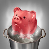 Financial Heat. Business concept as a piggybank in a pot of hot boiling water as a symbol for money problems and budget savings stress and finance anxiety Stock Photography