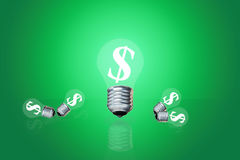 Financial idea Earned dollars to light a lamp.  Stock Photography