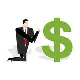 Financial idol. Businessman praying to dollar. Worship of money. Stock Images