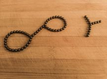 Financial Infinity Y symbol on wooden background stock photography