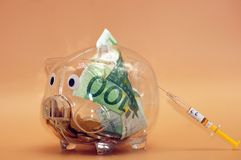 Financial injection for the piggy bank. Freed on neutral background royalty free stock photography