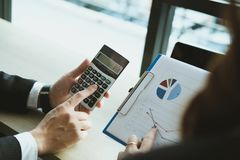 Financial inspector analyze accounting plan report. businessman. Working with new startup project. internal auditor audit performance revenue. business meeting Stock Photography